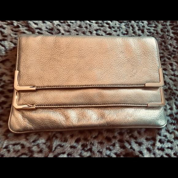 Michael Kors Handbags - MICHAEL KORS GOLD Leather Large Clutch